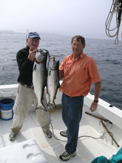 Joe and guest with salmon